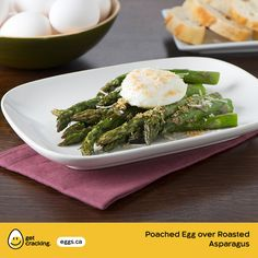 Poached Egg over Roasted Asparagus   Eggs.ca   #GetCracking #Eggs #Poached Keep it simple with this light spring recipe that is satisfying for every meal occasion.
