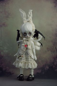 Alice in wonderland, cute and scary white rabbit