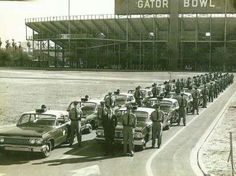 DUVAL COUNTY PATROL Duval County Patrol deputies pose with their 1963 Chevrolet Biscayne police cars in front of the old Gator Bowl stadium. Recently, 88 of its 123 survivors gathered to remember the old days. Police Cars, Police Vehicles, Gator Bowl, Jacksonville Florida, Old Florida, The Old Days, Historical Pictures, Law Enforcement, Old Things