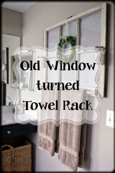 Old wooden window turned into a towel rack