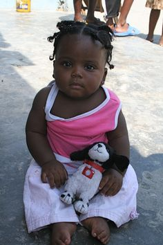 First photo..in the slum Cite Soleil, just outside of Port-au-Prince, Haiti by phoDOGrapher Leah Hudson