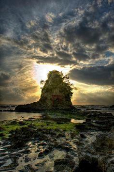 Torii on small islet at dusk in Amatsu-Kominato, Chiba Prefecture, Japan: photo by Jon Sheer