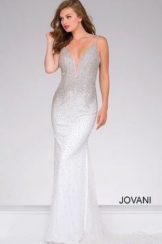 Floor length form fitting fully embellished prom dress features sleeveless  bodice with plunging v neck with 8eb35bae0