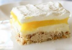 Lemon Lush ~ A light and fresh dessert with a shortbread crust. Layers of shortbread, cream cheese, lemon pudding, and fresh whipped cream make this Lemon Lush recipe the best of all. Lemon Lush Recipe, Lemon Recipes, Lemon Desserts, Just Desserts, Dessert Recipes, Easter Recipes, Holiday Recipes, Planning Menu, 9x13 Baking Dish