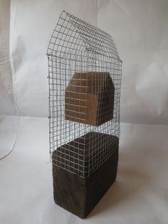 Wire mesh with floating wooden house, by Axel Stohlberg 2014
