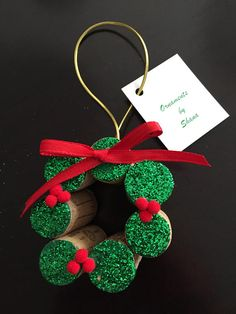 Wine Cork Wreath Mini Blinged up with Green paint green glitter and Red berry pompoms and red ribbon 3 X 3 Made from 7 recycled wine corks Wineries vary Cork Christmas Trees, Christmas Arts And Crafts, Christmas Ornament Crafts, Holiday Crafts, Snowman Ornaments, Christmas Christmas, Holiday Decor, Wine Cork Wreath, Wine Cork Ornaments