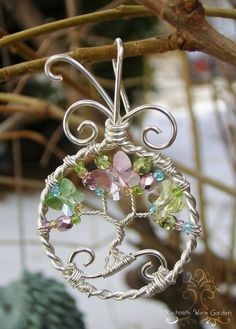 Sweet Spring Happy Spring everyone! This pendant was made out of silver-plated wire, fire-polished glass, and three beautiful Swarovski