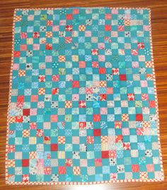I love a simple quilt that's just a bunch of squares. by amandasan, via Flickr