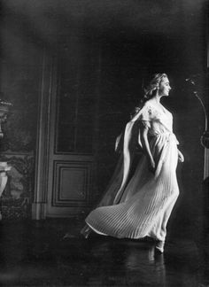 Margaret Philips wears an evening gown photographed by Henry Clarke, 1957.