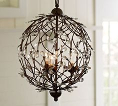 The branch-inspired Pottery Barn Camilla 3-Arm Globe Chandelier ($279, originally $349) includes tiny crystals that reflect light.