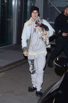 Celebs and their pets in 2016:     Justin Bieber carried a puppy at the airport after a gig in Krakow, Poland, on Nov. 6. - Splash News