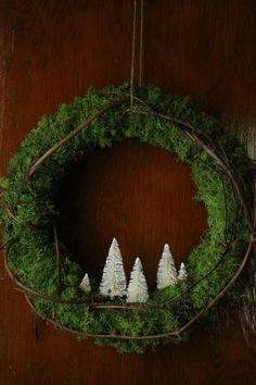 Love the idea of adding mini snow-fallen trees to a green wreath.