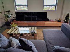 Tasmanian oak entertainment unit with pallet coffee table