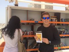 Outreach Coordinator Dan Herman placing outreach materials along the new Beach Library system. Please pray that these materials would fall into the hands of those searching for Truth. Searching, Round Sunglasses, Pray, Hands, Fall, Beach, Men, Fashion, Autumn