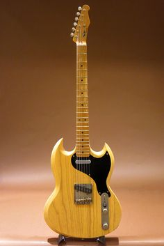 Interesting cross-breed of a Telecaster and SG. I kinda' want one now. :)