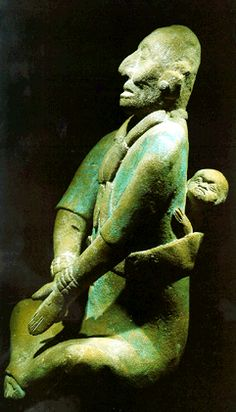 Maya mother with child on her back