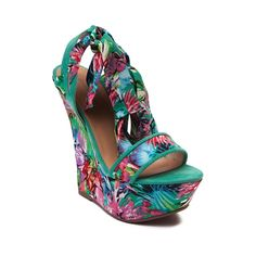 Shop for Womens Dollhouse Playful Wedge in Green Floral at Journeys Shoes. Shop today for the hottest brands in mens shoes and womens shoes at Journeys.com.Tie up your tropical style with the Playful Wedge from Dollhouse! The Playful Wedge rocks an open-toe design with floral printed faux suede uppers and ankle wrap halter that ties into a flirtatious bow. Available for shipment in April; Pre-order yours today!Features include Floral printed faux suede uppers Covered wedge Heel height 5.5…