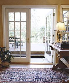 So much better than a plain sliding glass door, don't you think? Also, I love that rug. Cozy Basement, Basement Windows, Walkout Basement, Basement Ideas, Condo Decorating, Tuscan Decorating, Door Window Covering, Sliding Glass Door, Glass Doors