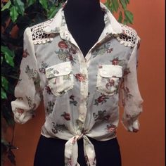 RESERVED BEAUTIFUL SEMI SHEER TIE WAIST BLOUSE Beautiful combo of floral print and crocheted detail.. Tie at waist and elastic cinch in the back.. Sleeves go from 3/4 to long Truth Tops Blouses