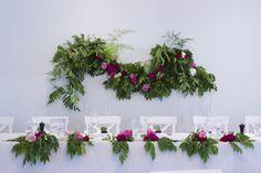 Lush greenery & fuchsia backdrop #garland #wedding