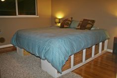 DONT LOVE THE LOOK inFront- WOULD NEED a bed skirt! DIY Bed frame and storage. Really easy and works well for smaller rooms! Add a door at the end where it's open and a lock on the inside, equals great hiding spot from intruders. Diy Storage Space, Diy Storage Bed, Storage Baskets, Homemade Beds, Homemade Bed Frames, Diy Platform Bed, Diy Bed Frame, New Beds, New Room