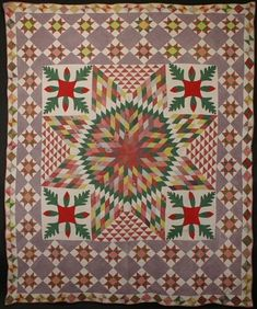 "Stars with Applique Quilt: Circa 1870; Pennsylvania  Dense patterning makes this combination of Star of Bethlehem; Oakleaf; Variable Star and Hourglass a real knock-out. Graduated sizes of each frame add to the drama of the large central star. Colors and fabrics have mellowed with washing. Likely a unique combination of patterns. Measures 82"" x 99""; circa 1870. Pennsylvania origin."