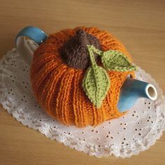 Pretty Pumpkin Tea Cozy.  The link is broken, but it was too cute not to pin anyway :)  I am sure some of you yarn-crafty pinners could figure this out.  And if you do, PLEASE post it to me here!  --Meggie
