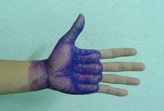 Crazy thumbs up tattoo.