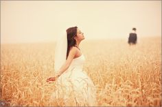love this!! but the groom should have been out of frame or a little more in focus, maybe looking at her?