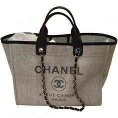 Buy your chanel grey deauville tote Chanel on Vestiaire Collective, the luxury consignment store online. Second-hand Chanel grey deauville tote Chanel Grey in Cloth available. Burberry Handbags, Chanel Handbags, Purses And Handbags, Handbags Online, Luxury Bags, Luxury Handbags, Designer Handbags, Replica Handbags, Coco Chanel