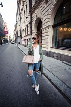 Kenza in Trench coat and knitted sweater from IvyRevel // Prada bag // jeans…