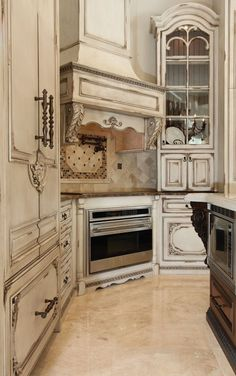 Old world finish....I love these cabinets and hardware.