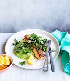 CRISP-SKINNED SALMON WITH PEA PURÉE AND SOFT-HERB SALAD - Elegant and full of great textures, this dish is special enough to serve at your next dinner party yet quick enough to whip up for a midweek meal. To keep things extra simple, strip the herb salad back to just two herbs.