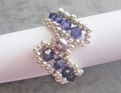 This ring tutorial includes details, easy step by step instructions with colour photos/pictures and materials list. The ring is made using Swarovski bicone, pearl and seed beads, which are easily available. Time required approximately 1 hr Number of pages 12 Number of Steps 30 Skill