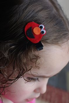 Elmo hair clip. REVIEW- super easy to throw together and my daughter was thrilled!! I made two. One with an alligator clip and another with a snap clip.