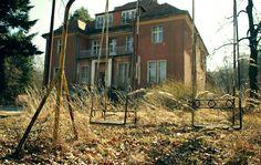 overgrown playground swingset by Jakub Golis
