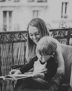 Mom and baby reading on Paris balcony (@householdmagny)