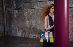 Rianne van Rompaey wears the graphic new iteration of the BOSS Bespoke bag