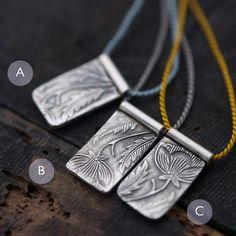 Mini Victorian Floral tags on silk cord necklace von Minicyn, €70.00