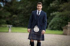 The Arran Tweed Kilt Hire includes a contemporary navy tweed jacket and waistcoat, kilt, and all essential Highlandwear accessories. Grooms In Kilts, Men In Kilts, Kilt Men, Kilt Wedding, Kilt Hire, Feminine Traits, Kilt Jackets, Modern Kilts, Kilt Accessories