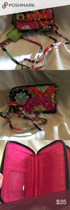 Vera Bradley Ziggy Zinnia Crossbody for i phone6 Has Wristlet  or crossbody straps . Has two zip pockets . Places for cash , coins , cards , phone . Has a plastic cover for I.D . Cards and papers . 6 1/2 wide . 4 inches in height . A pocket on outside is 6 1/4 . Vera Bradley Bags Crossbody Bags