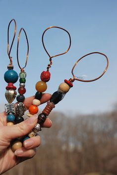 beautiful bubble wands - strong wire bent into a loop and wrapped ... then extending wire is threaded with beads of choice and then wire is twisted and tucked at end.