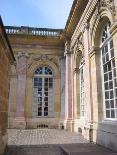In the Gardens & Park of Versailles : The Grand Trianon Palace with it's beautiful rose marble pilasters & columns.