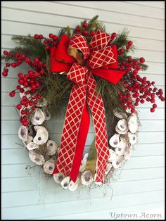 Oyster shell wreath via www.uptownacorn.blogspot.com. I don't care so much for the ribbon--I'd choose more of a classic tartan (MacFarlane, Lennox and Christie are all pretty red/greens. Or I'd take it in the silver/ivory/pearl palette. What a lovely tribute to MD's heritage!