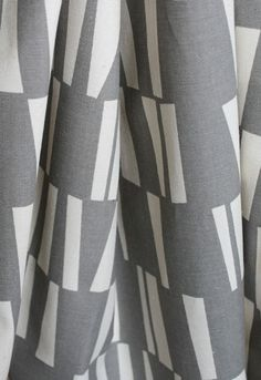 mid century inspired fabric print in wet concrete grey with creamy off white.