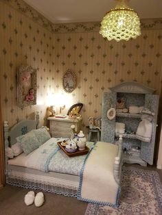 Miniature bedroom in my French Dollhouse. Cabinet & bed handmade by Jolanda Knoop