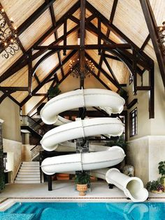 Now THIS is a cool home feature - an indoor waterslide! What do you think of having a giant waterslide in your house?