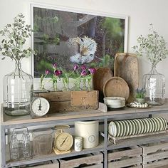 Love these industrial shelves filled with farmhouse finds eclecticallyvintage.com