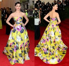 Emmy Rossum singlehandedly brings forth springtime in a fluorescent-yellow Carolina Herrera strapless floral gown that would have the Nasonex bee buzzing in ecstasy. Ruby-hued Van Cleef & Arpels earrings, a red mani and matching lips contrast with the blooming motif.