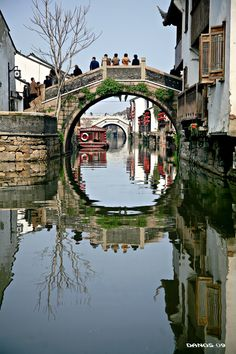 Xitang (UNESCO World Heritage) is in Jiashan County, Zhejiang Province_ East China. Xitang is known for its 104 bridges of varied structure, all from de Ming n Qing Dynasties. Shops n houses in Xitang r built on riversides. There r total of 123 lanes.